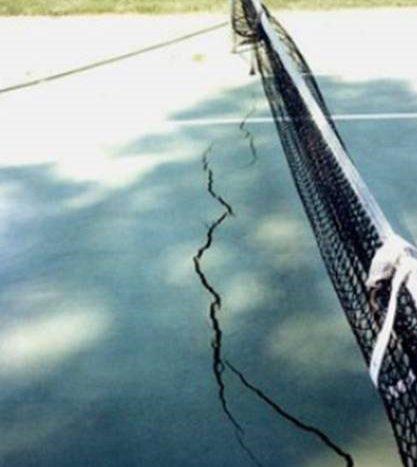 cracked-tennis-court-Deshayes-Dream-Courts