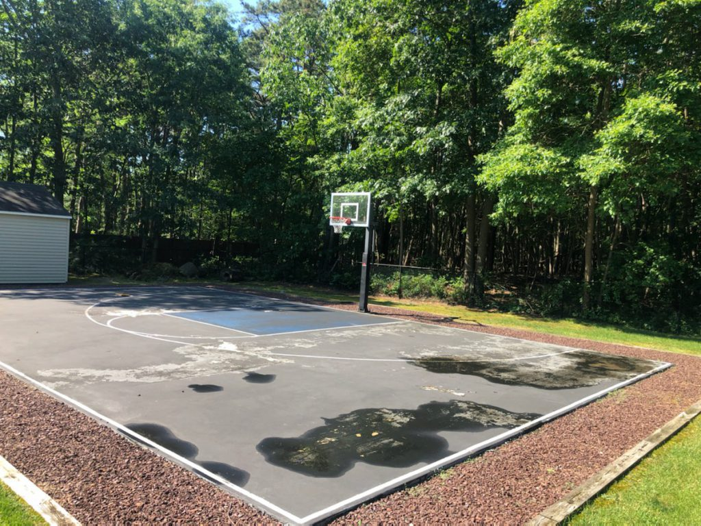 damaged-basketball-court-in-need-of-repair-DeShayes-Dream-Courts